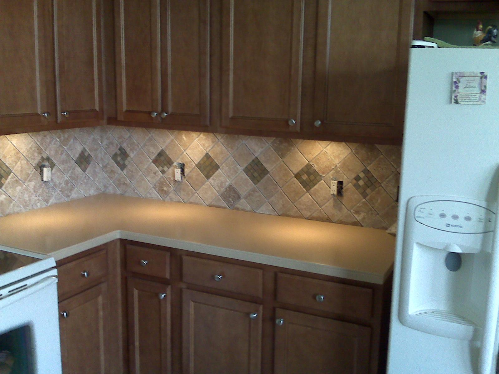 tumbled marble backsplash with under counter lighting